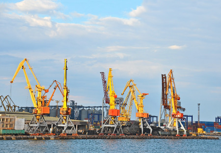 Cargo crane, freight traine and coal in port Stock Photo
