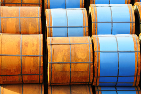 Stacked steel metal-roll, ready for shipment in port Stock Photo