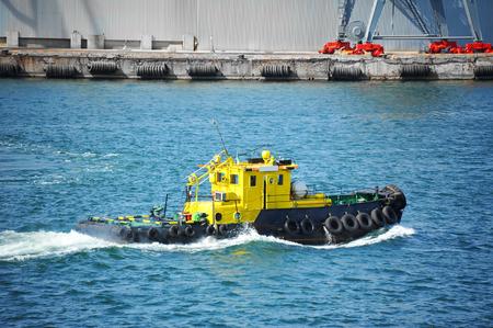 Tugboat in harbor quayside on Odessa, Ukraine