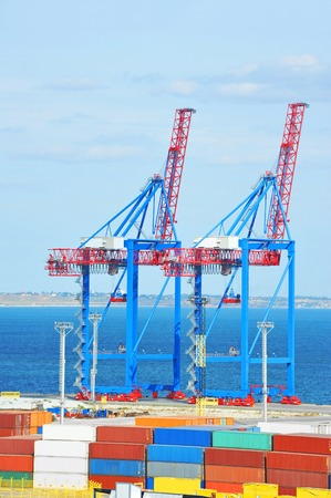 Port cargo crane and container, ready for shipment Stock Photo