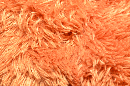 Close up of brown synthetical fur textured background