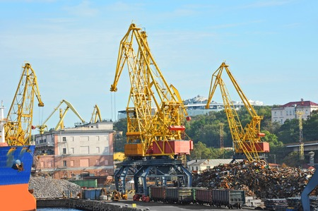 Freight train, ship and scrap metal in port