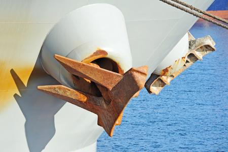 Rusty anchor mechanism on bulk ship hull