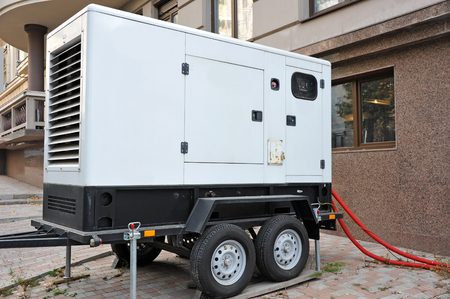 Mobil electric generator with power cable on street Banque d'images