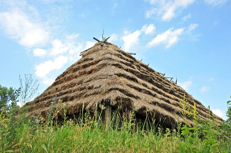 Ancient traditional rural cottage with a straw roof Stock Photo