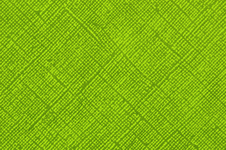 Embossed paper background, green color, close up