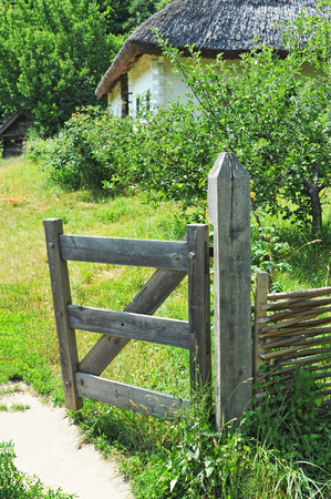 Vintage wooden rural gate in garden, Pirogovo, Kiev, Ukraine Stock Photo