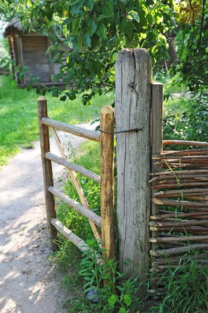 Vintage wooden rural gate in garden, Pirogovo, Kiev, Ukraine Stock Photo