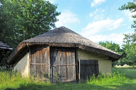 Ancient traditional ukrainian rural wooden barn, Kiev, Ukraine Stock Photo