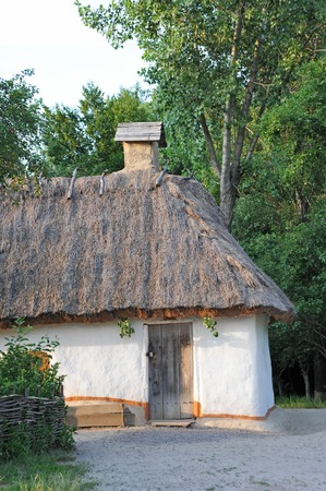 Ancient traditional ukrainian mud hut in forest Stock Photo