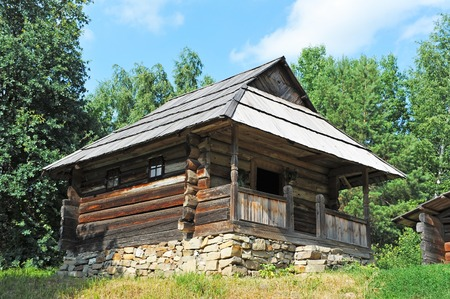 Ancient traditional ukrainian forest carpatian cottage in forest
