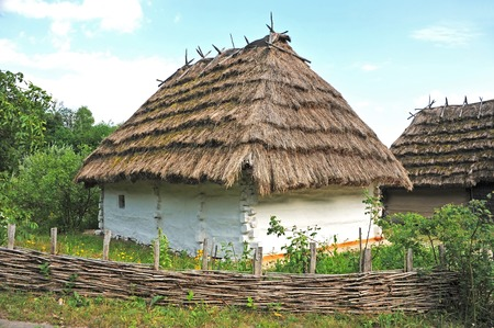 Ancient traditional ukrainian mud hut in forest Editorial