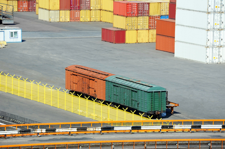 Cargo container stack and train in port