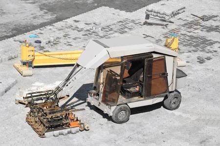 Paving stone machine on road construction site Stock Photo