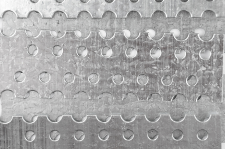 Perforated textured stell metallic background, close up Stock Photo