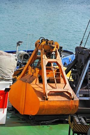crane bucket: Rusty scoop of cargo crane on the  deck