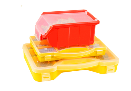 Screw and dowel in plastic organizer box Stock Photo