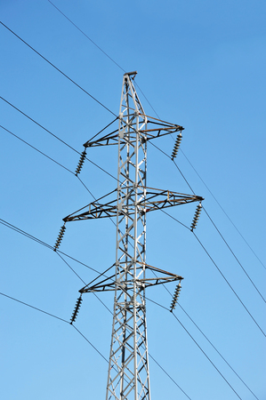 Electric lines pylon on blue sky background Stock Photo