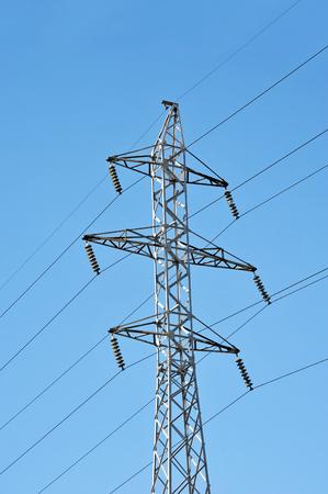 Electric lines pylon on blue sky background Stock Photo