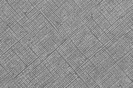 Embossed paper background, gray color, close up