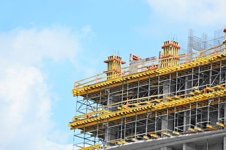 realestate: Building construction site work against blue sky Stock Photo
