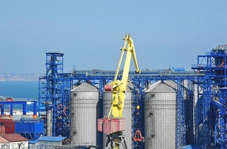 dryer: Cargo crane and grain silo in port Odessa, Ukraine Stock Photo