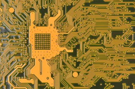 Close up of printed orange computer circuit board