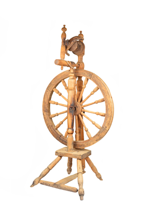 Antique wooden spinning wheel, isolated on white background