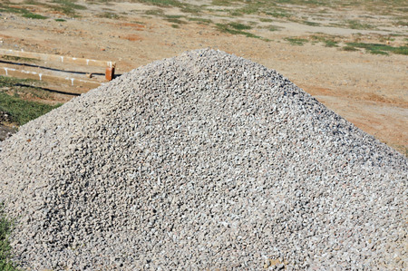 Pile of gravel on building construction site Imagens