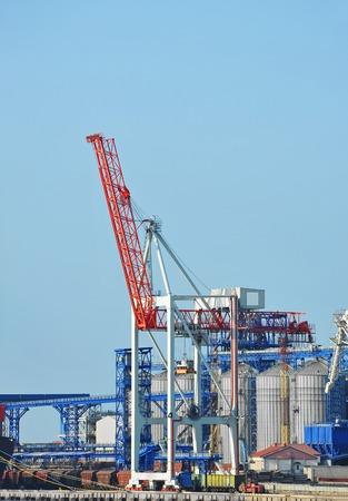 Cargo crane and grain silo in port Odessa, Ukraine Stock Photo