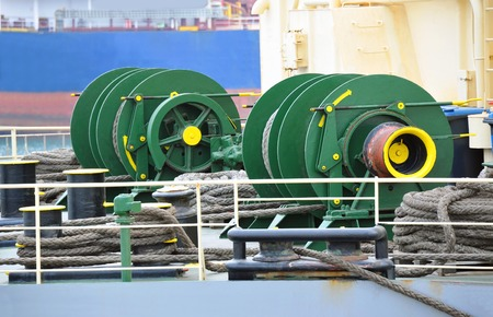 Mooring winch mechanism with hawser on ship deck Editorial
