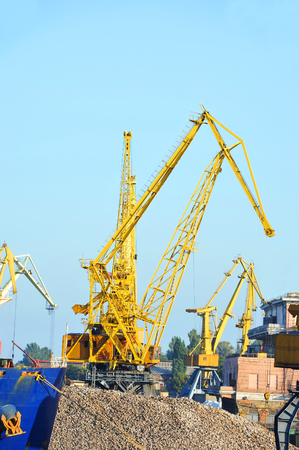 Cargo crane, ship and pig iron in port