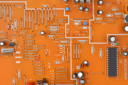 Close up of printed red VHS player circuit board Stock Photo