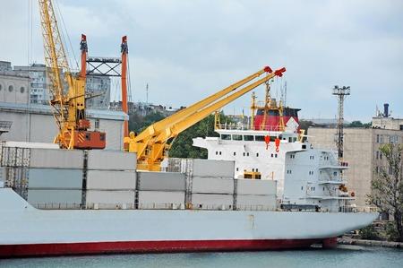 Port cargo crane, ship and container, Odessa, Ukraine 写真素材