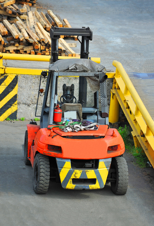 Red forklift truck, machine for loading freight Stock Photo