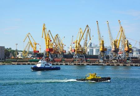 Tugboat and crane in harbor quayside on Odessa, Ukraine 写真素材