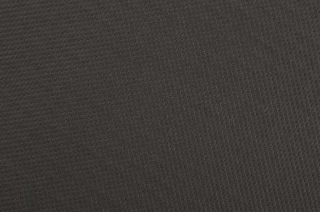 Embossed paper background, black color, close up