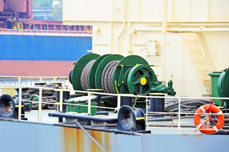 Mooring winch mechanism with hawser on ship deck Stock Photo