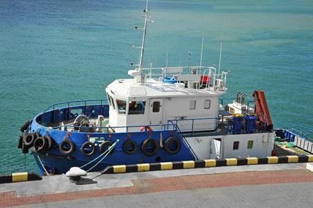 Platform supply vessel (PSV) in harbor quayside