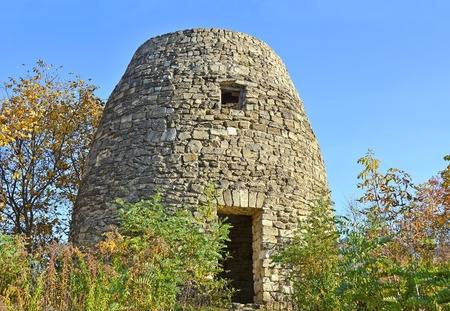 Antique ruin of ramshackle windmill, Pirogovo, Kiev, Ukraine Stock Photo
