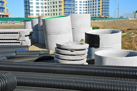 Concrete circle pit and PVC pipe on construction site