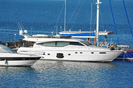 White motor yacht near harbor pier, Odessa, Ukraine Stock Photo
