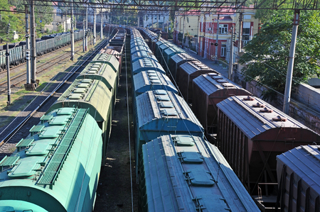 Freight train on railway in industrial zone