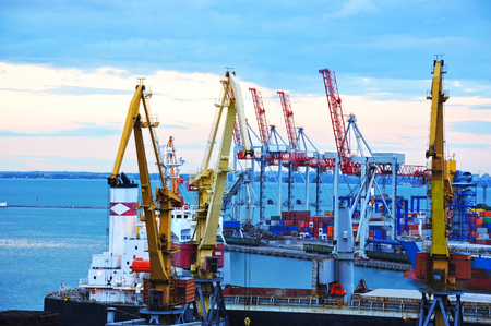 Port cargo crane, ship and container at sunset
