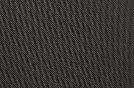 Nahaufnahme des strukturierten synthetischen Hintergrunds des Polyesters