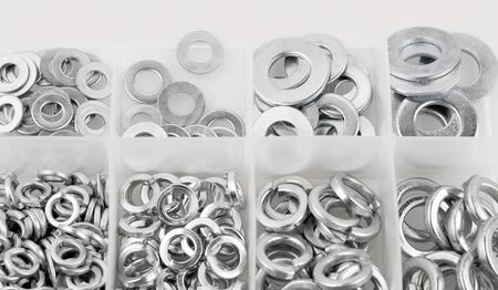 Assorted steel washer in plastic organizer box, Banque d'images