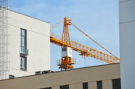 Crane and building under construction against blue sky Reklamní fotografie
