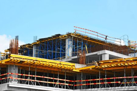 Building construction site work against blue sky Zdjęcie Seryjne