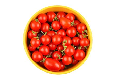 Tomato in bowl, isolated on white background