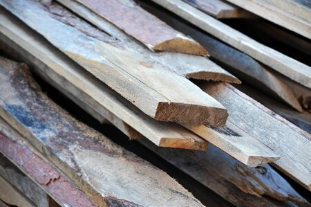 Old wooden beam, stacked at construction site